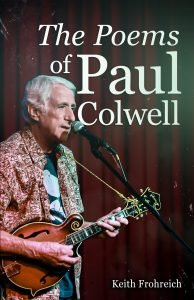 Photo of the book cover The Poems of Paul Colwell featuring Paul playing a guitar in front of a red curtain.